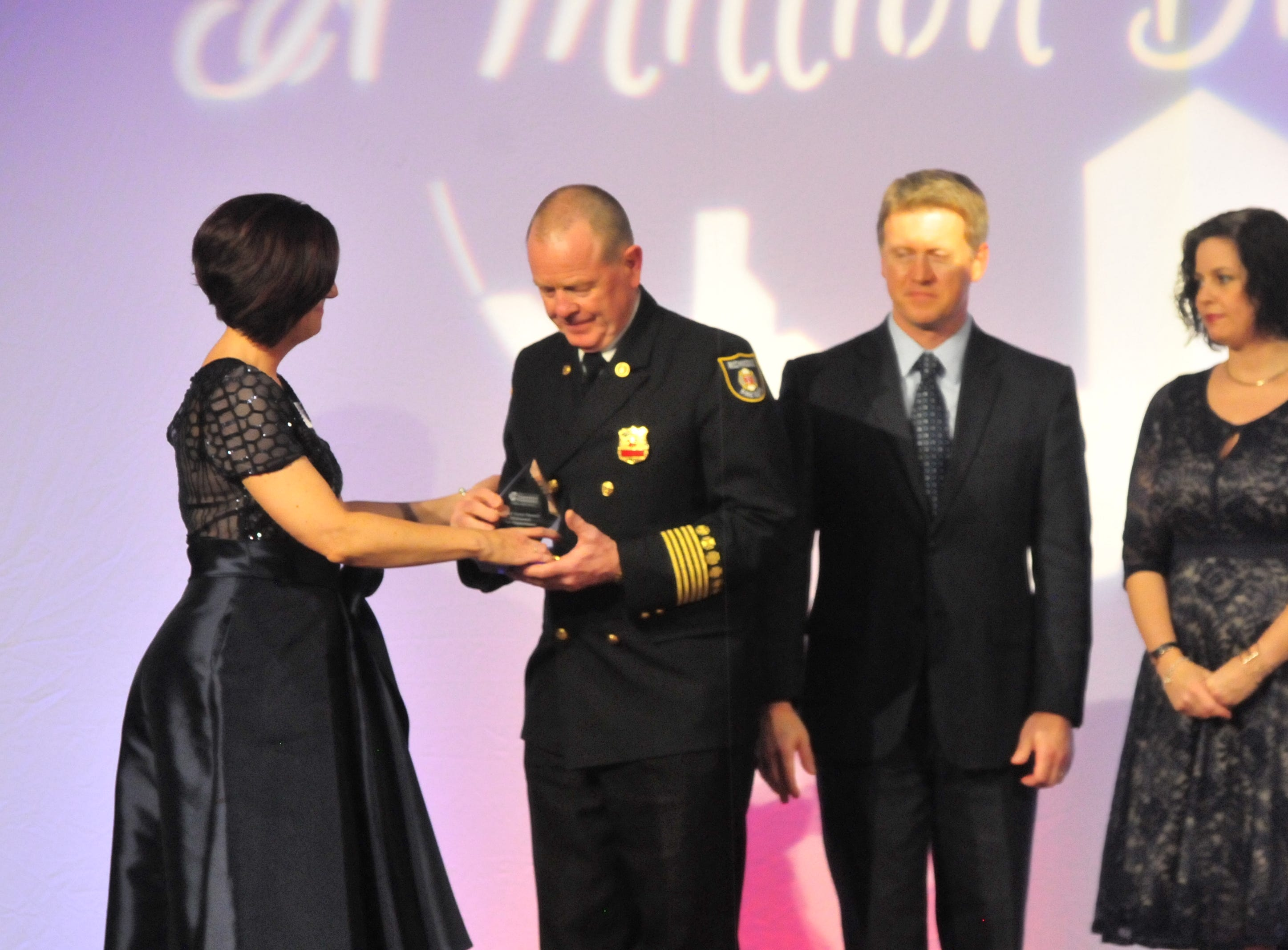 Richmond Fire Department Chief Jerry Purcell accepts the award for Emergency Services Professional of the Year.