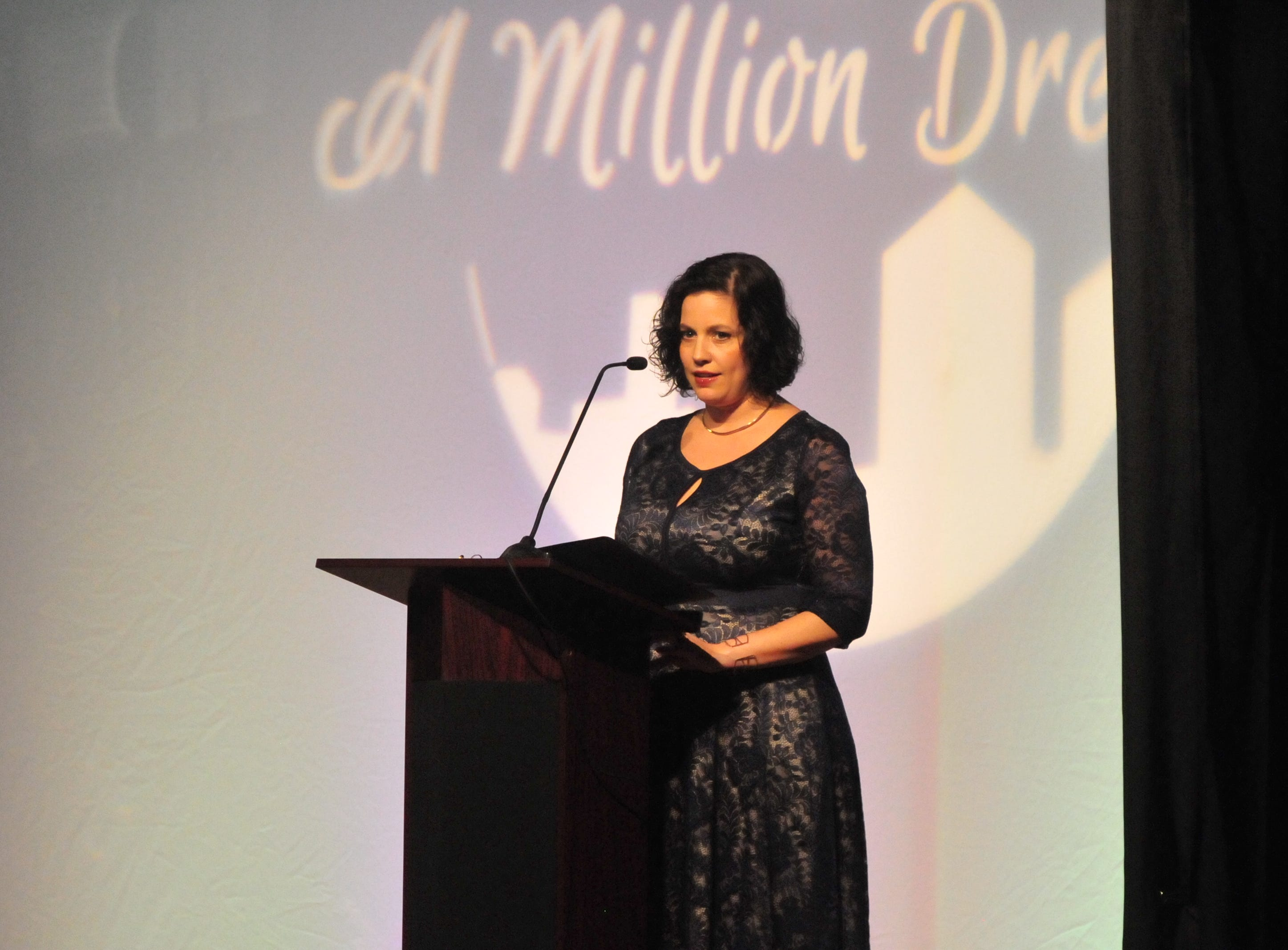 """Sherrilyn Johnson, the 2019 president of the Wayne County Area Chamber of Commerce board, speaks Friday night during the Chamber's """"A Million Dreams"""" dinner."""