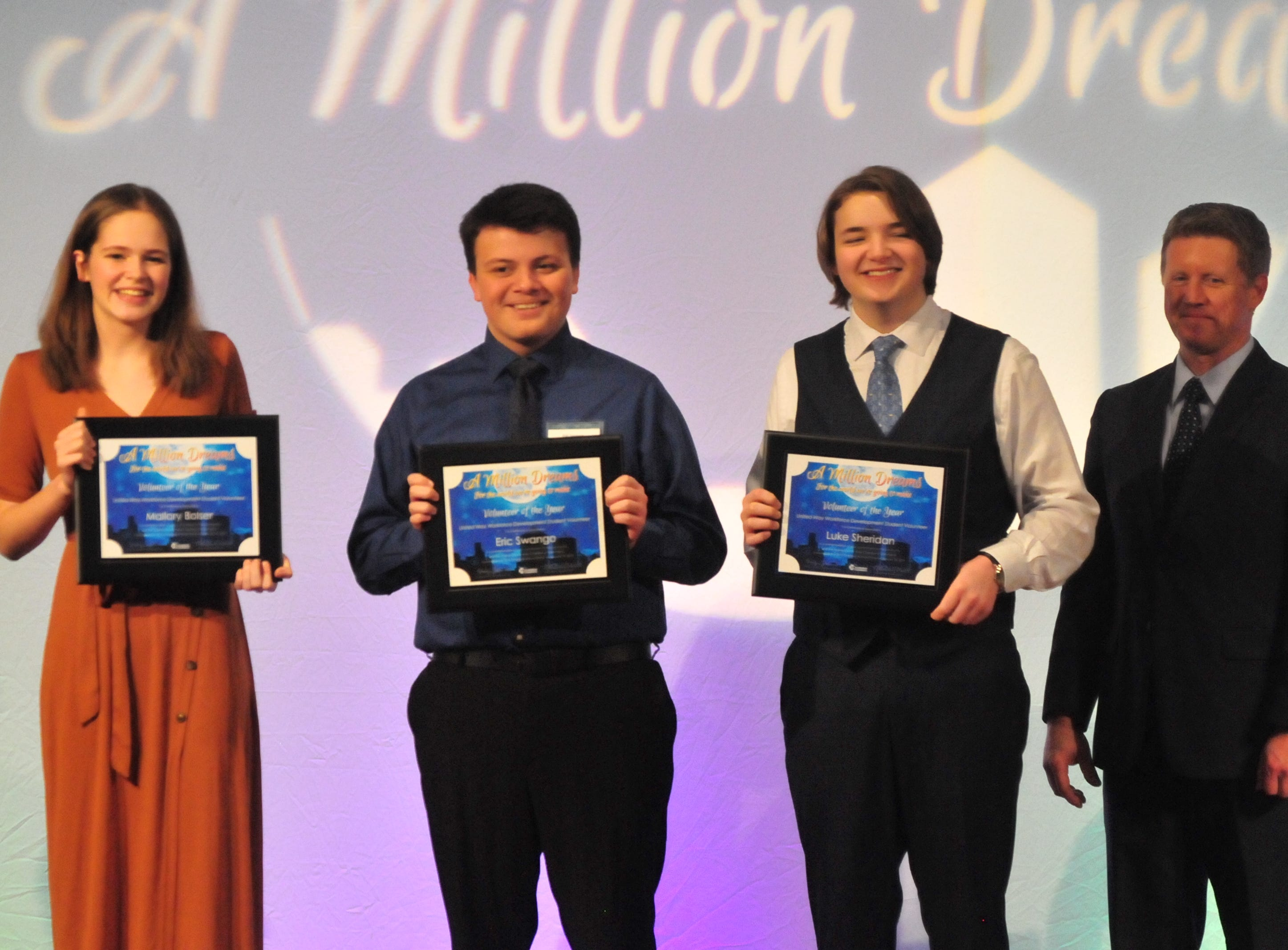Mallory Bolser, Eric Swango and Luke Sheridan were honored Friday night as Volunteers of the Year for the Wayne County Area Chamber of Commerce.