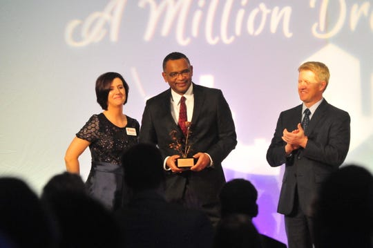 Avis Stewart received a standing ovation when he was presented the Art Vivian Distinguished Community Leader award Friday night.