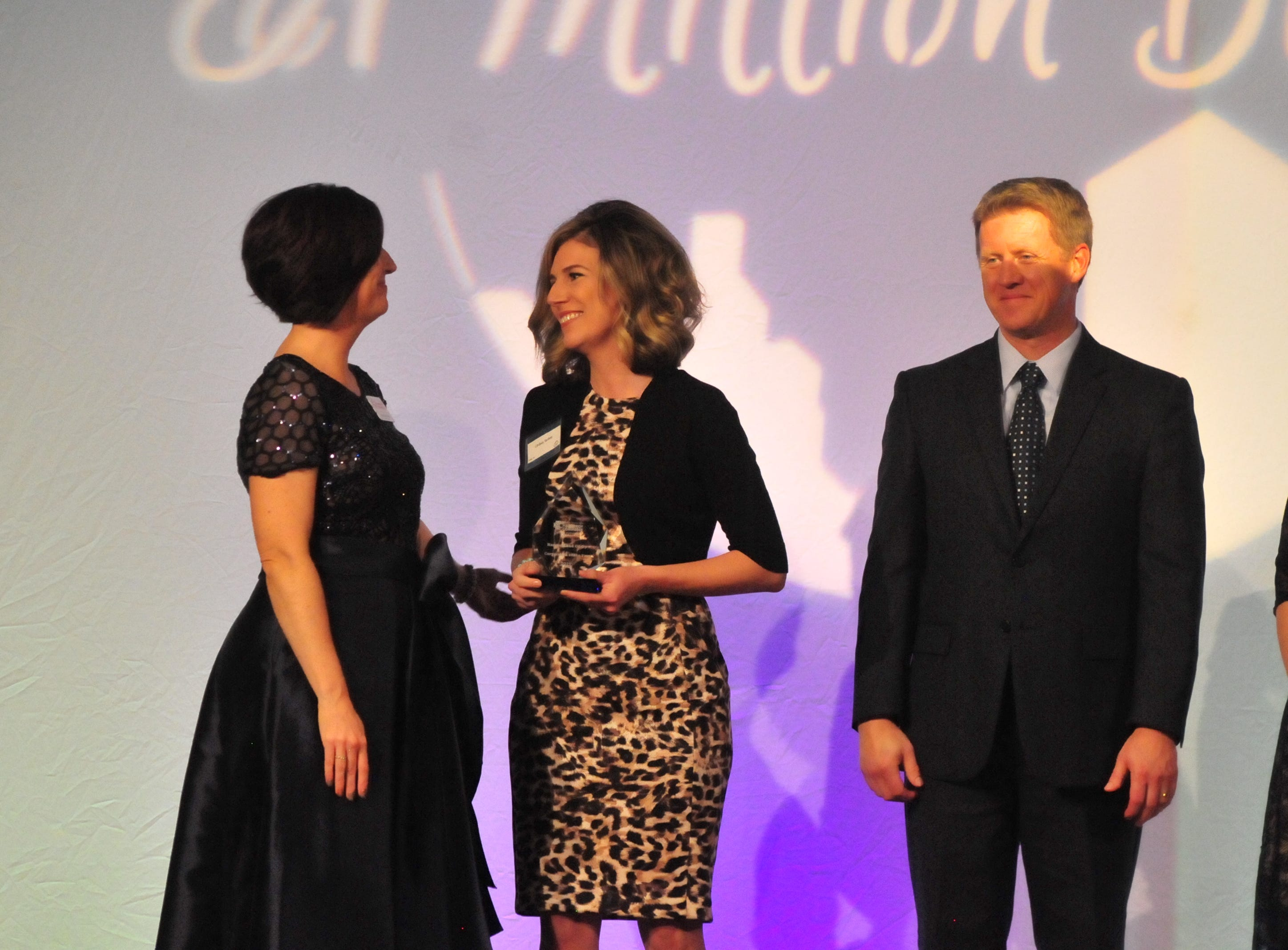 Lindsay Sankey accepts the Corporation of the Year award for Harvest Land Co-op.