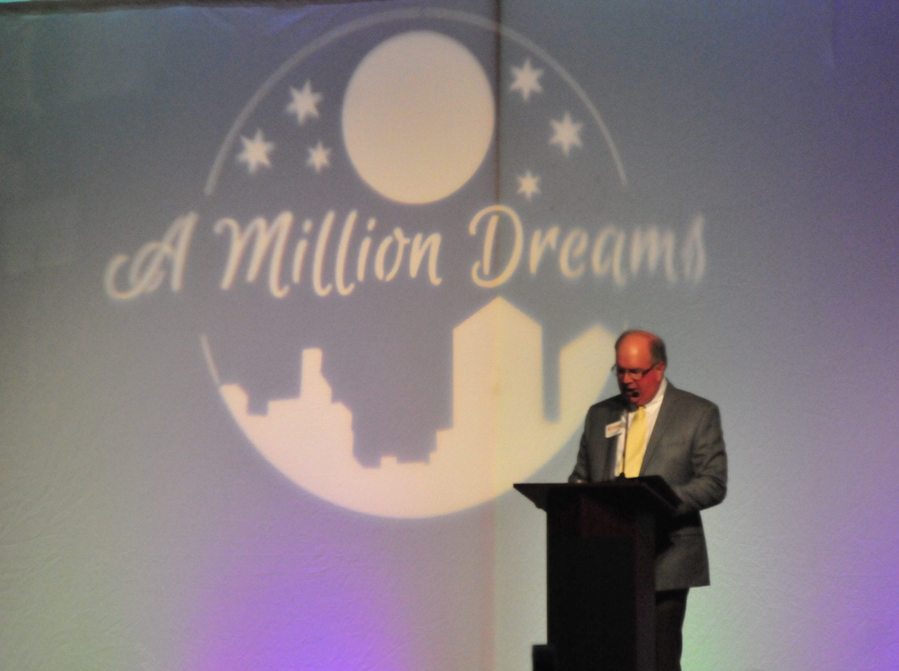 """Lee Elzemeyer, president of the Wayne County Area Chamber of Commerce board in 2018, speaks Friday night at the Chamber's dinner, """"A Million Dreams."""""""