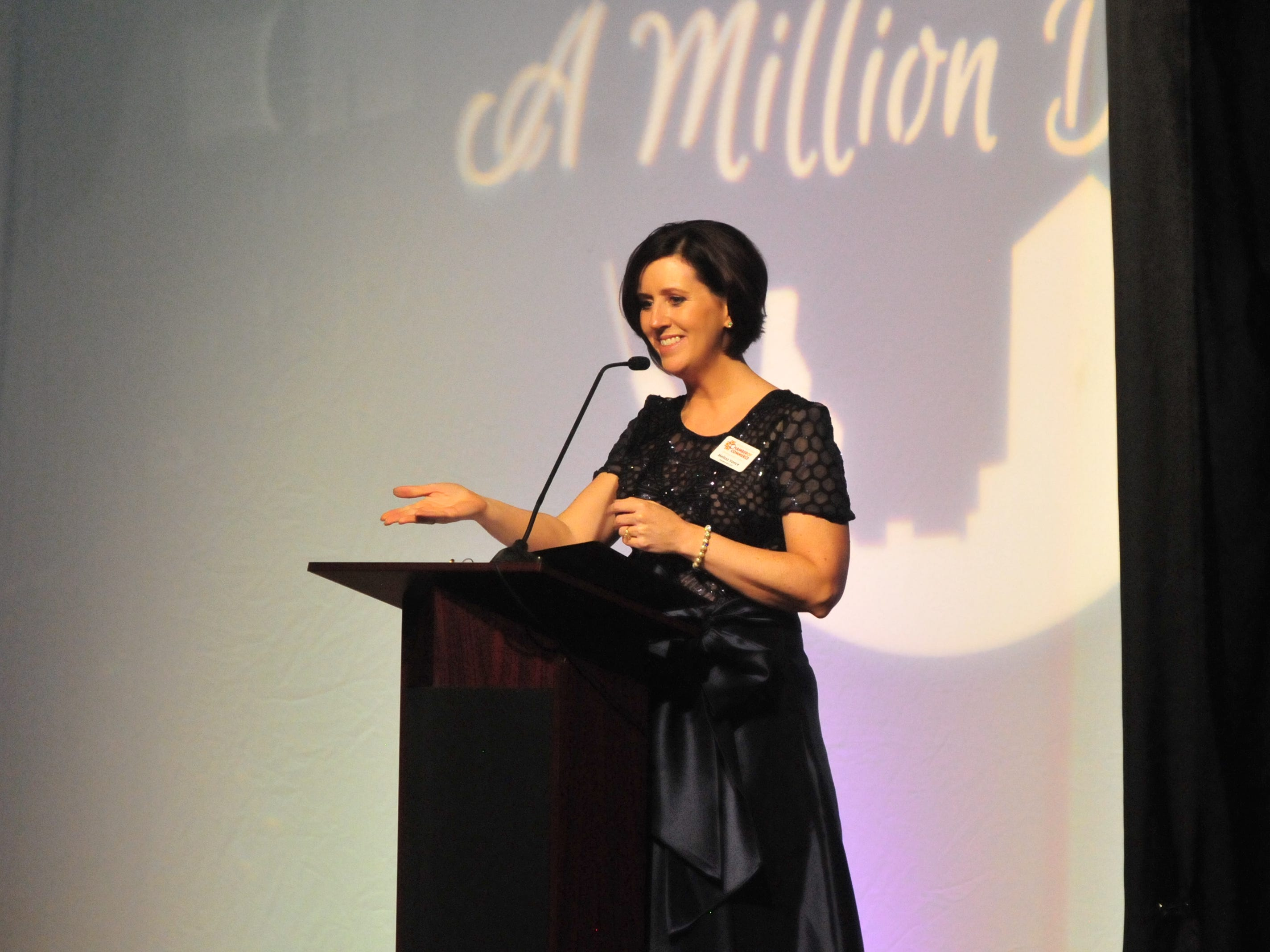 """Melissa Vance, president and CEO of the Wayne County Area Chamber of Commerce, speaks Friday night during the Chamber's dinner, """"A Million Dreams."""""""
