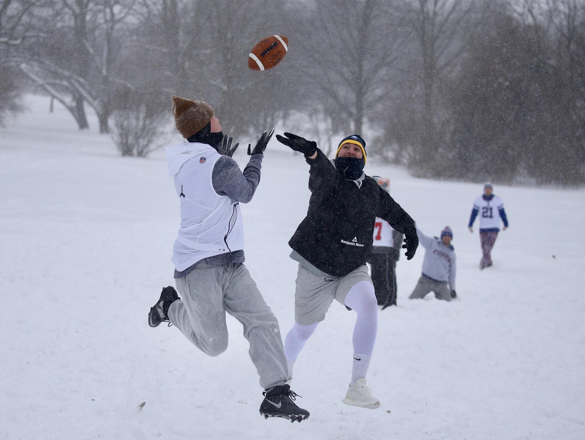 The frigid temperatures and heavy snowfall didn't stop a group of friends from playing football at Cobbs Hill Park. Connor O'Dell gets behind Nick Polisseni for a TD catch.