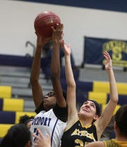Brockport's Shinya Lee and Athena's Isabella DeRubeis go up for a rebound.