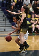 Athena's Kiera Osier defends against Brockport's GG Allen.