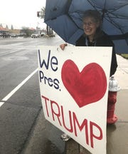 Rita McComas of Anderson displays a sign Saturday during the Build That Wall! rally on Hilltop Drive in Redding.
