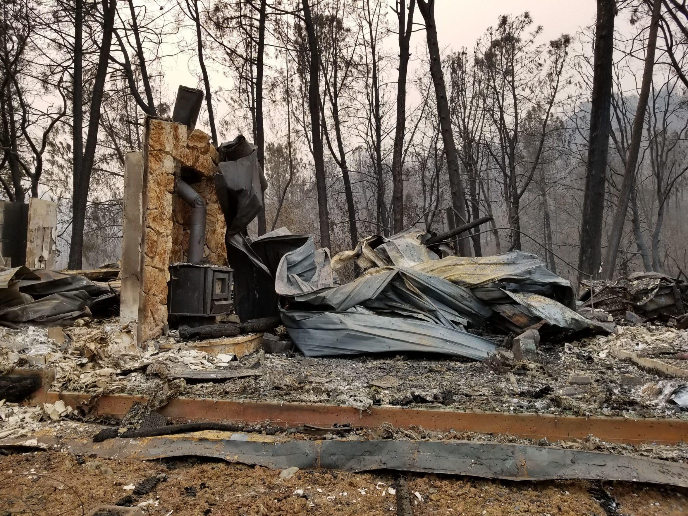 The remains of Lynne and Phil Pearson's Shasta home after the Carr Fire tore through it in July.