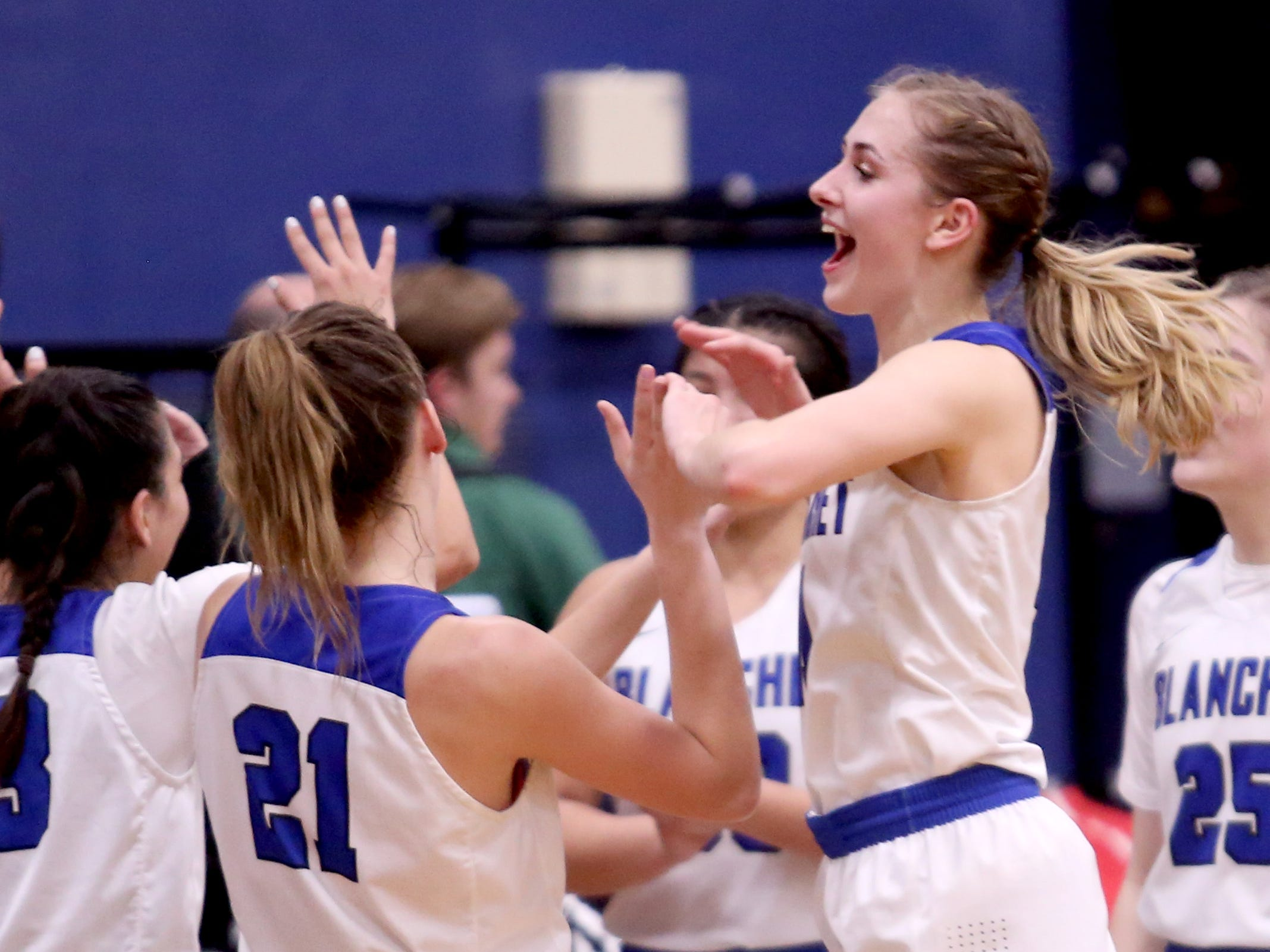 Blanchet Catholic players celebrate their win following the Salem Academy vs. Blanchet Catholic girls basketball game at Blanchet Catholic School in Salem on Friday, Jan. 18, 2019. Blanchet Catholic won the gam 48-40.