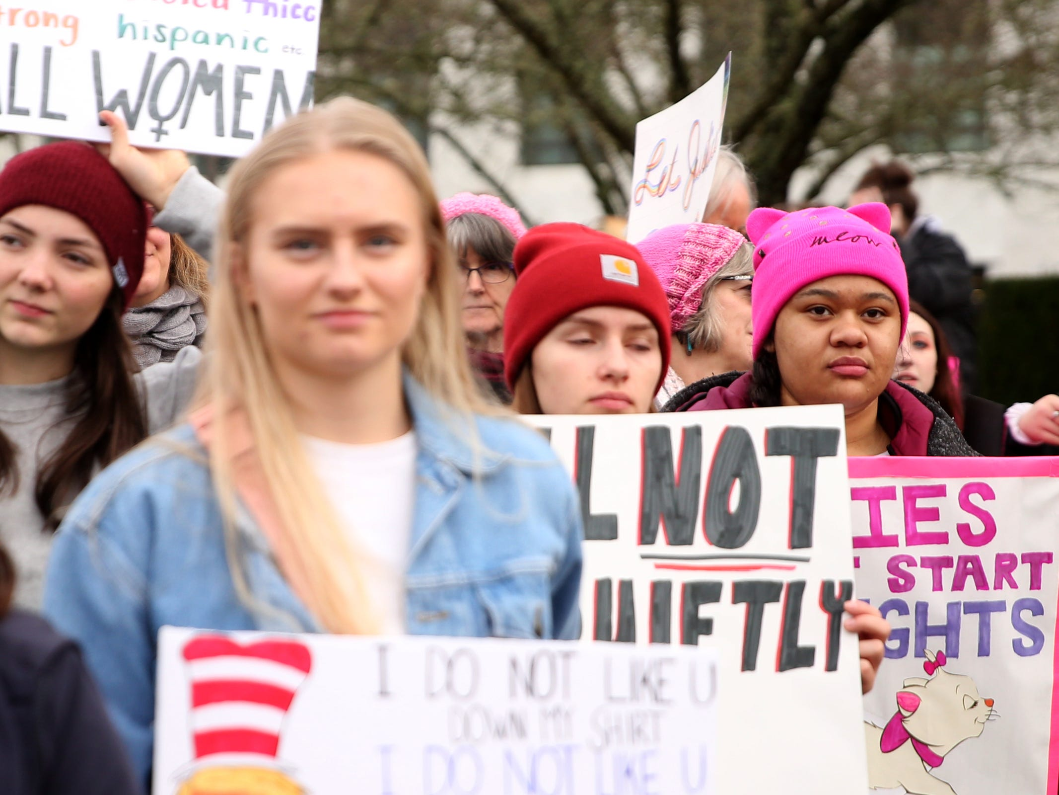 Lemon Marin, 18, of Salem, far right, attends the Women's March Salem outside the Oregon State Capitol on Saturday, Jan. 19, 2019.