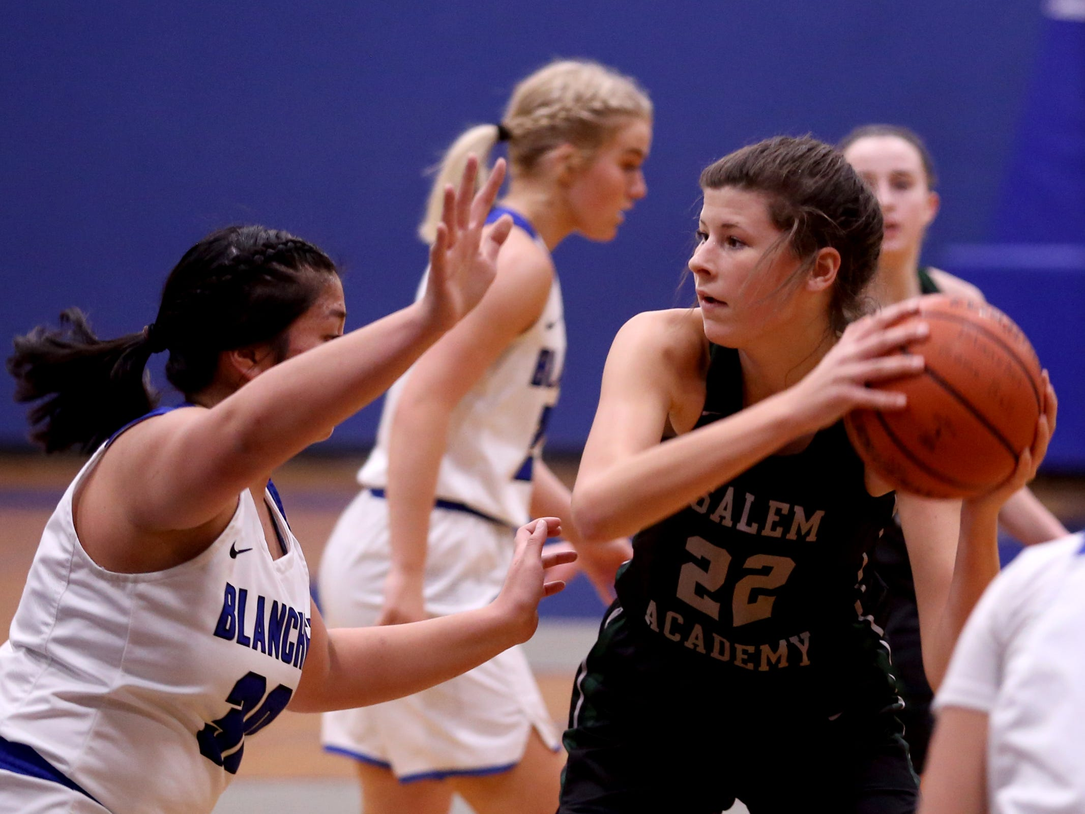 Salem Academy's Chloe Baker (22) holds on to the ball in the first half of the Salem Academy vs. Blanchet Catholic girls basketball game at Blanchet Catholic School in Salem on Friday, Jan. 18, 2019. Blanchet Catholic won the gam 48-40.