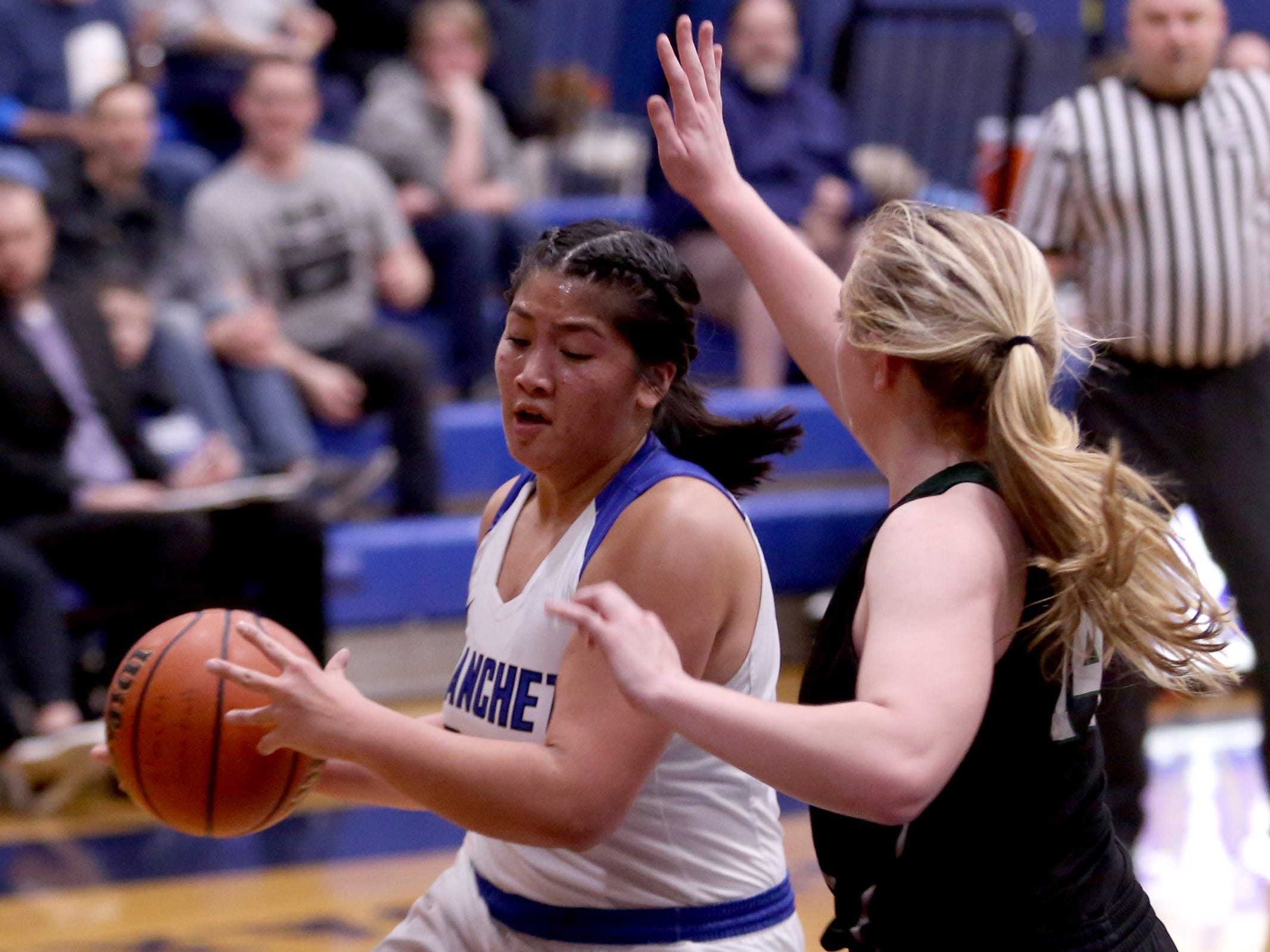 Blanchet Catholic's Kalea Salang (30) moves around Salem Academy's Grace Brown (14) in the second half of the Salem Academy vs. Blanchet Catholic girls basketball game at Blanchet Catholic School in Salem on Friday, Jan. 18, 2019. Blanchet Catholic won the gam 48-40.