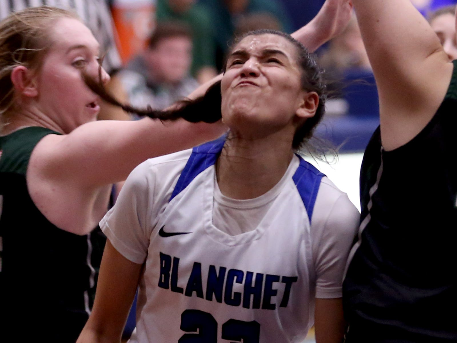 Blanchet Catholic's Ana Coronado (23) forces her way to the basket in the second half of the Salem Academy vs. Blanchet Catholic girls basketball game at Blanchet Catholic School in Salem on Friday, Jan. 18, 2019. Blanchet Catholic won the gam 48-40.