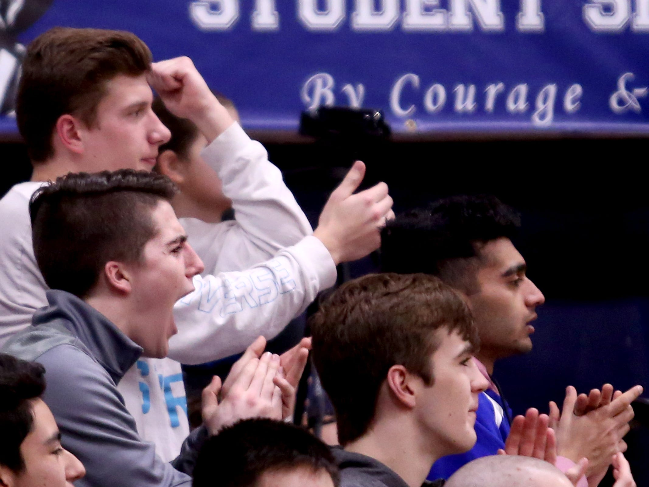 Blanchet Catholic fans celebrate a play in the first half of the Salem Academy vs. Blanchet Catholic girls basketball game at Blanchet Catholic School in Salem on Friday, Jan. 18, 2019. Blanchet Catholic won the gam 48-40.