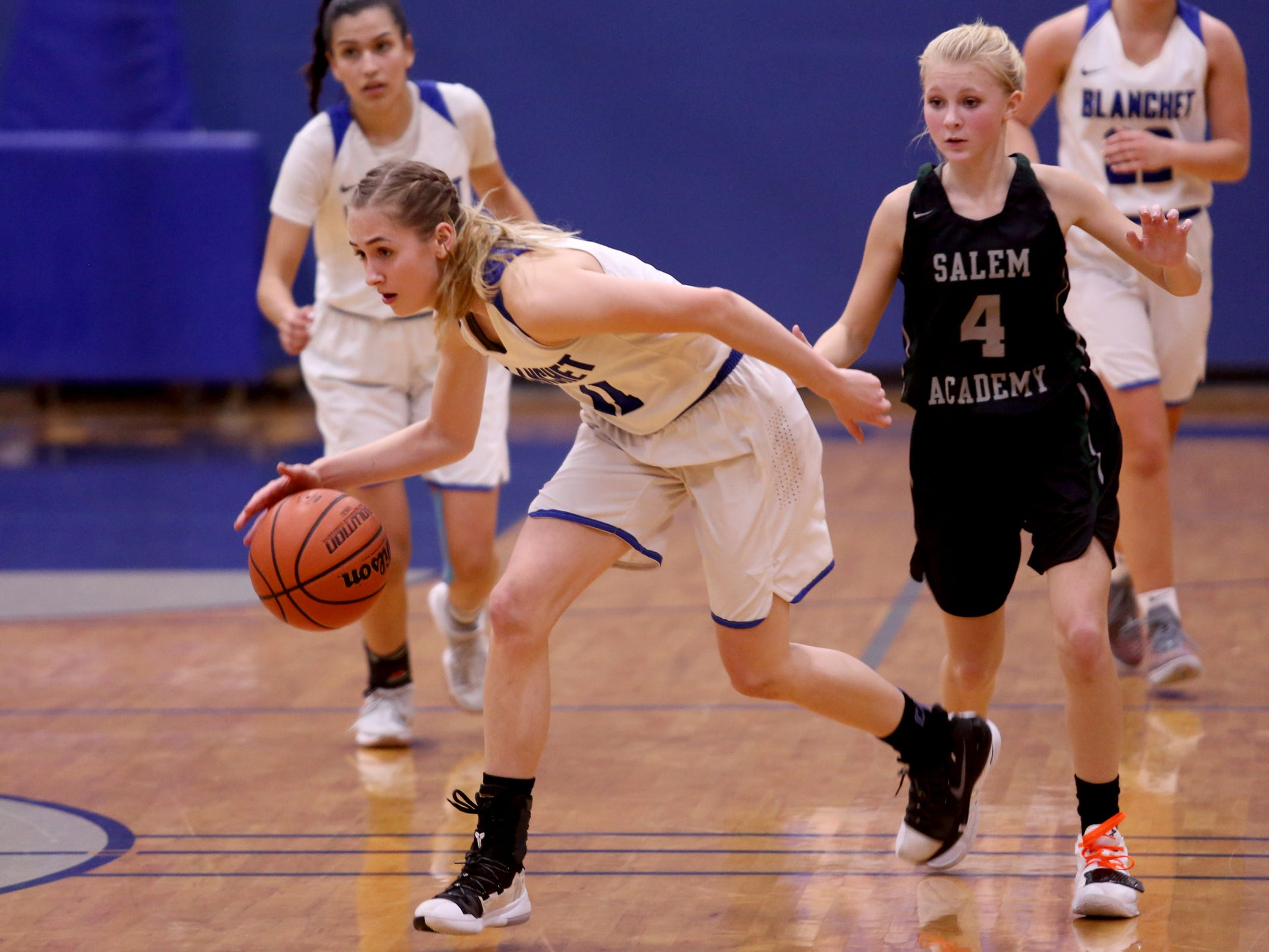 Blanchet Catholic's Trinity Phipps (11) claims  the loose ball in the second half of the Salem Academy vs. Blanchet Catholic girls basketball game at Blanchet Catholic School in Salem on Friday, Jan. 18, 2019. Blanchet Catholic won the gam 48-40.