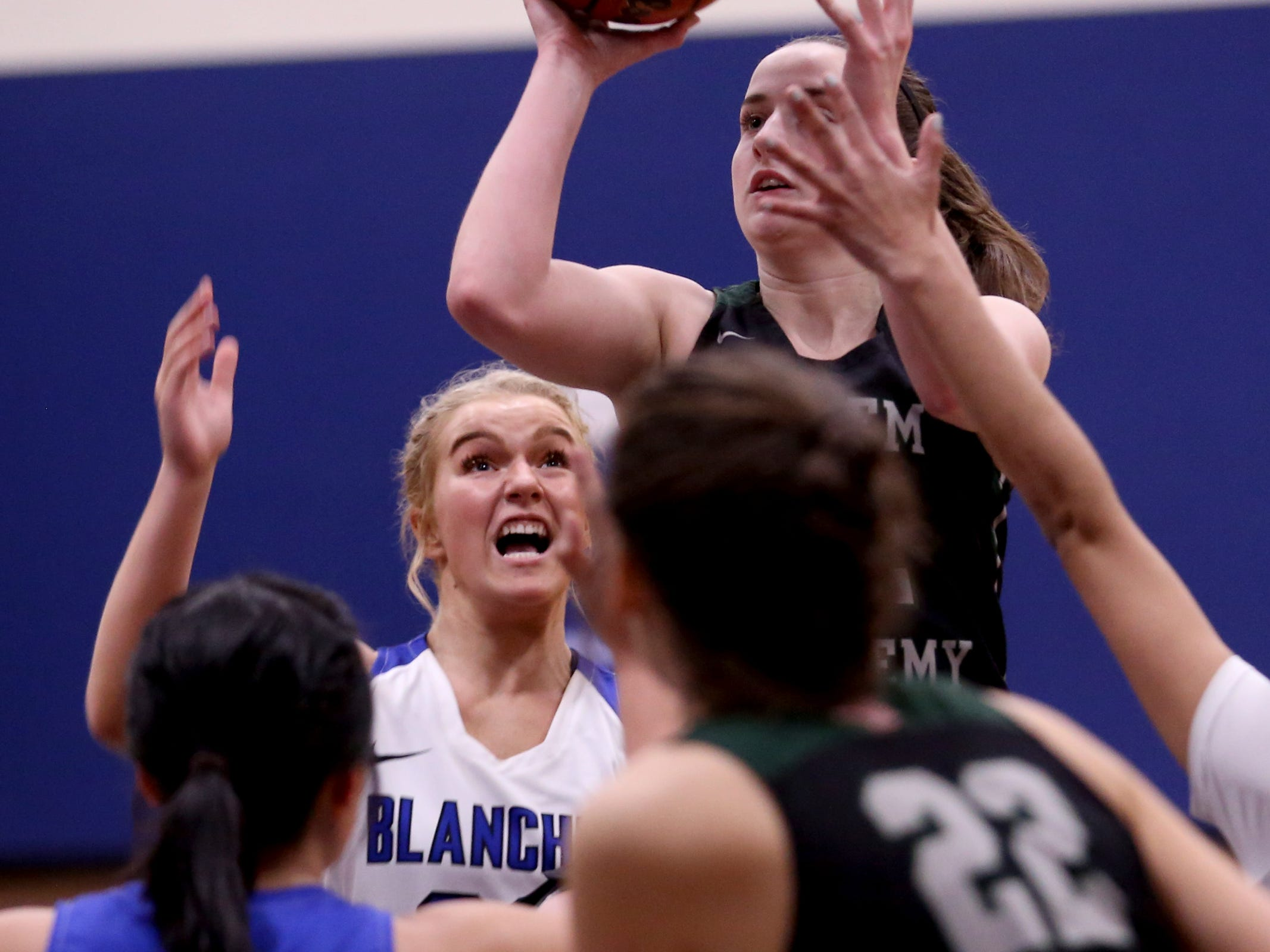 Salem Academy's Kirsten Koehnke (12) shoots over Blanchet Catholic's Bailey Hittner (22) in the first half of the Salem Academy vs. Blanchet Catholic girls basketball game at Blanchet Catholic School in Salem on Friday, Jan. 18, 2019. Blanchet Catholic won the gam 48-40.
