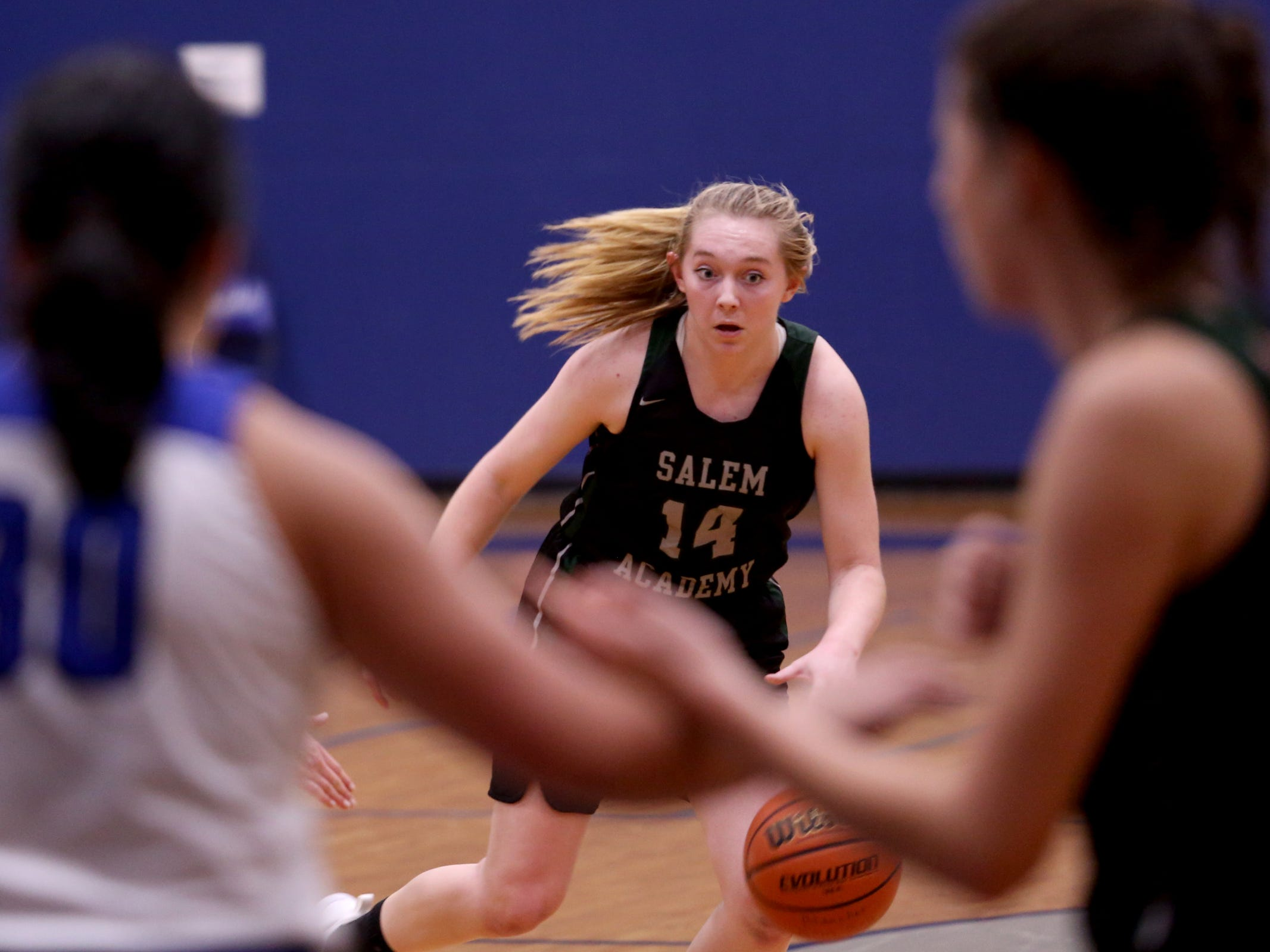 Salem Academy's Grace Brown (14) moves with the ball in the first half of the Salem Academy vs. Blanchet Catholic girls basketball game at Blanchet Catholic School in Salem on Friday, Jan. 18, 2019. Blanchet Catholic won the gam 48-40.