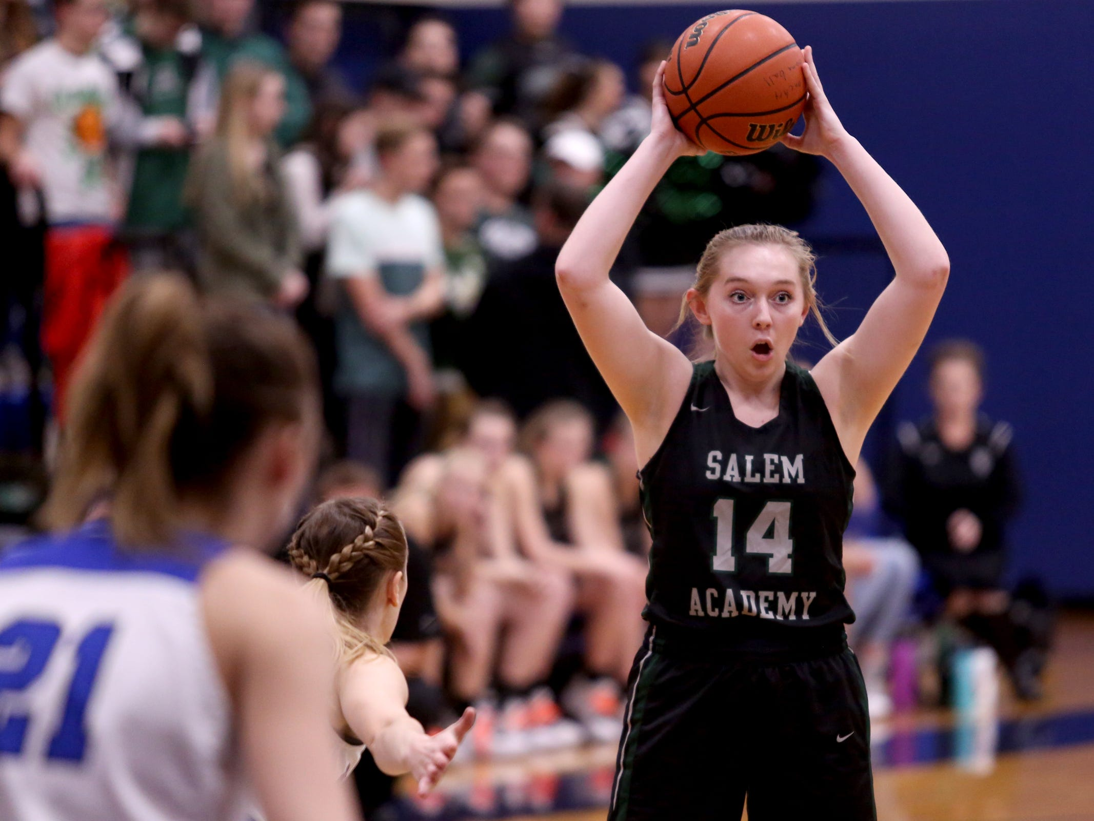 Salem Academy's Grace Brown (14) looks to pass the ball in the first half of the Salem Academy vs. Blanchet Catholic girls basketball game at Blanchet Catholic School in Salem on Friday, Jan. 18, 2019. Blanchet Catholic won the gam 48-40.