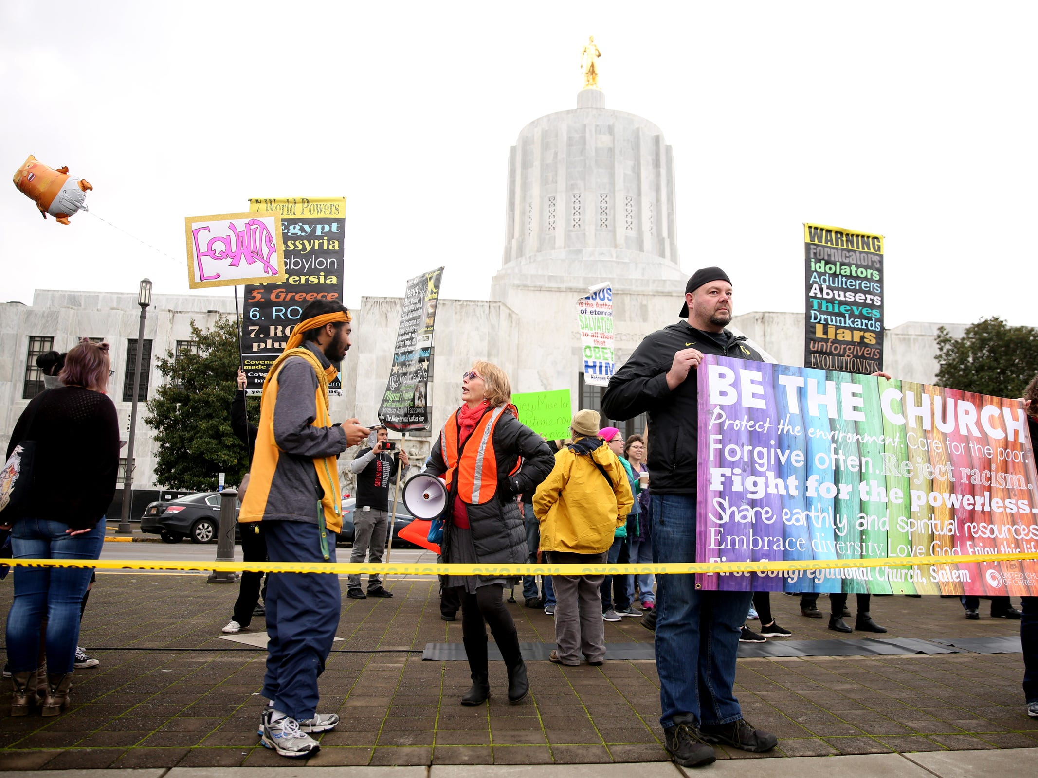 People surround counter-protesters during the Women's March Salem outside the Oregon State Capitol on Saturday, Jan. 19, 2019.