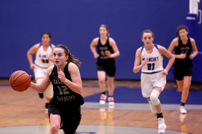 Salem Academy's Kirsten Koehnke (12) races to the basket in the first half of the Salem Academy vs. Blanchet Catholic girls basketball game at Blanchet Catholic School in Salem on Friday, Jan. 18, 2019. Blanchet Catholic won the gam 48-40.