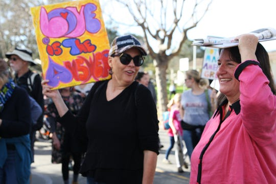 Marchers joked and laughed with one another as they walked the blocks from Colton House to the Monterey wharf.