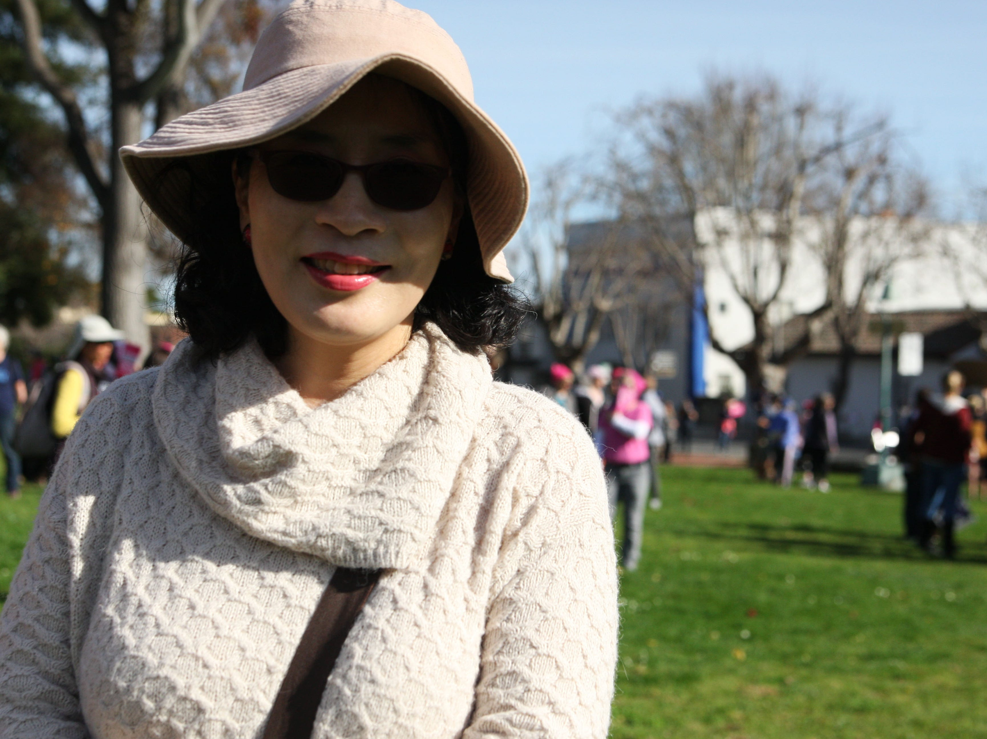 Masako Toki turned out to march Saturday because she believes in America as the best country in the world, she said, but she believes it has gone astray.