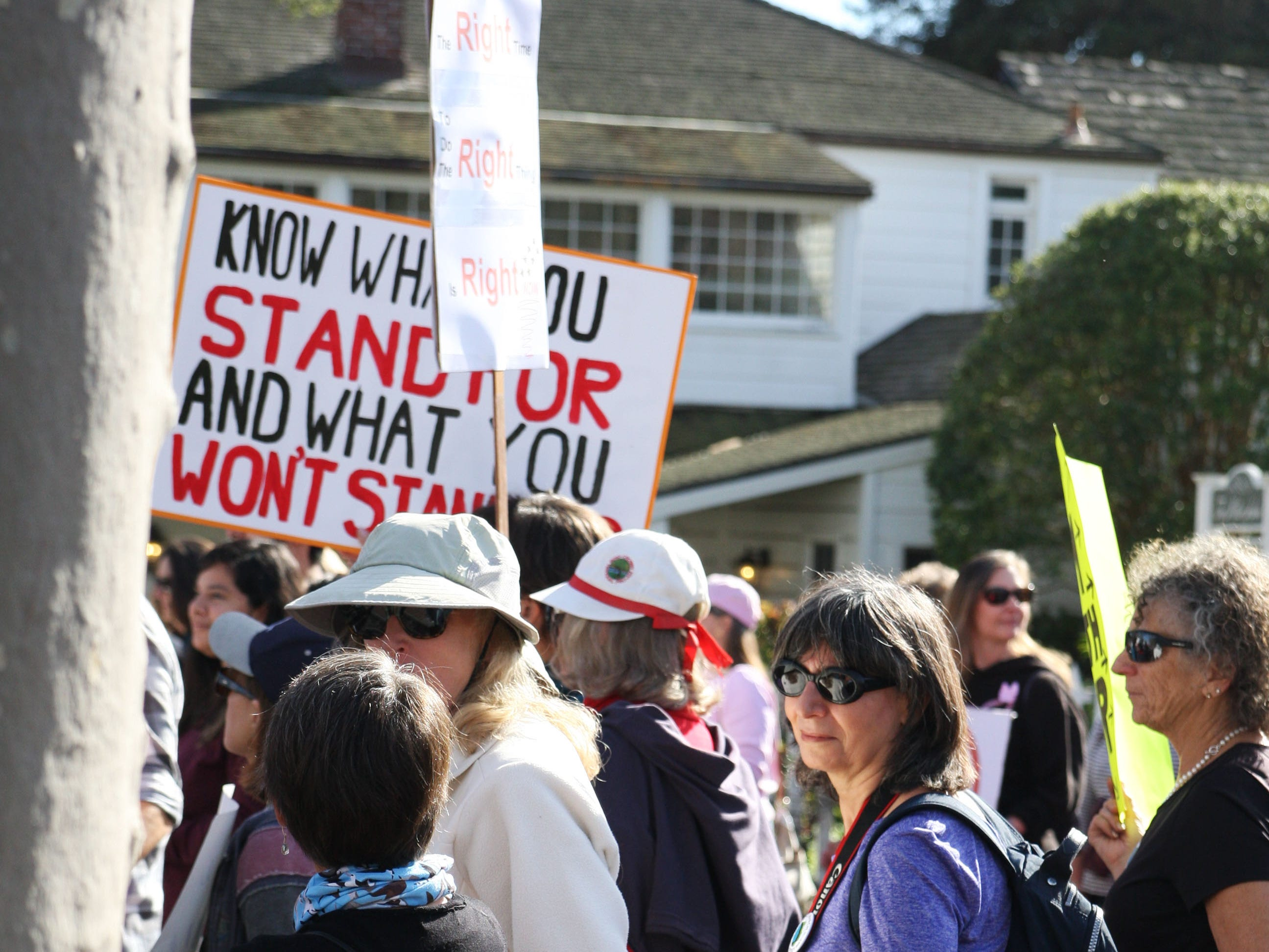 Marchers walked from Colton House in Monterey to the wharf Saturday.