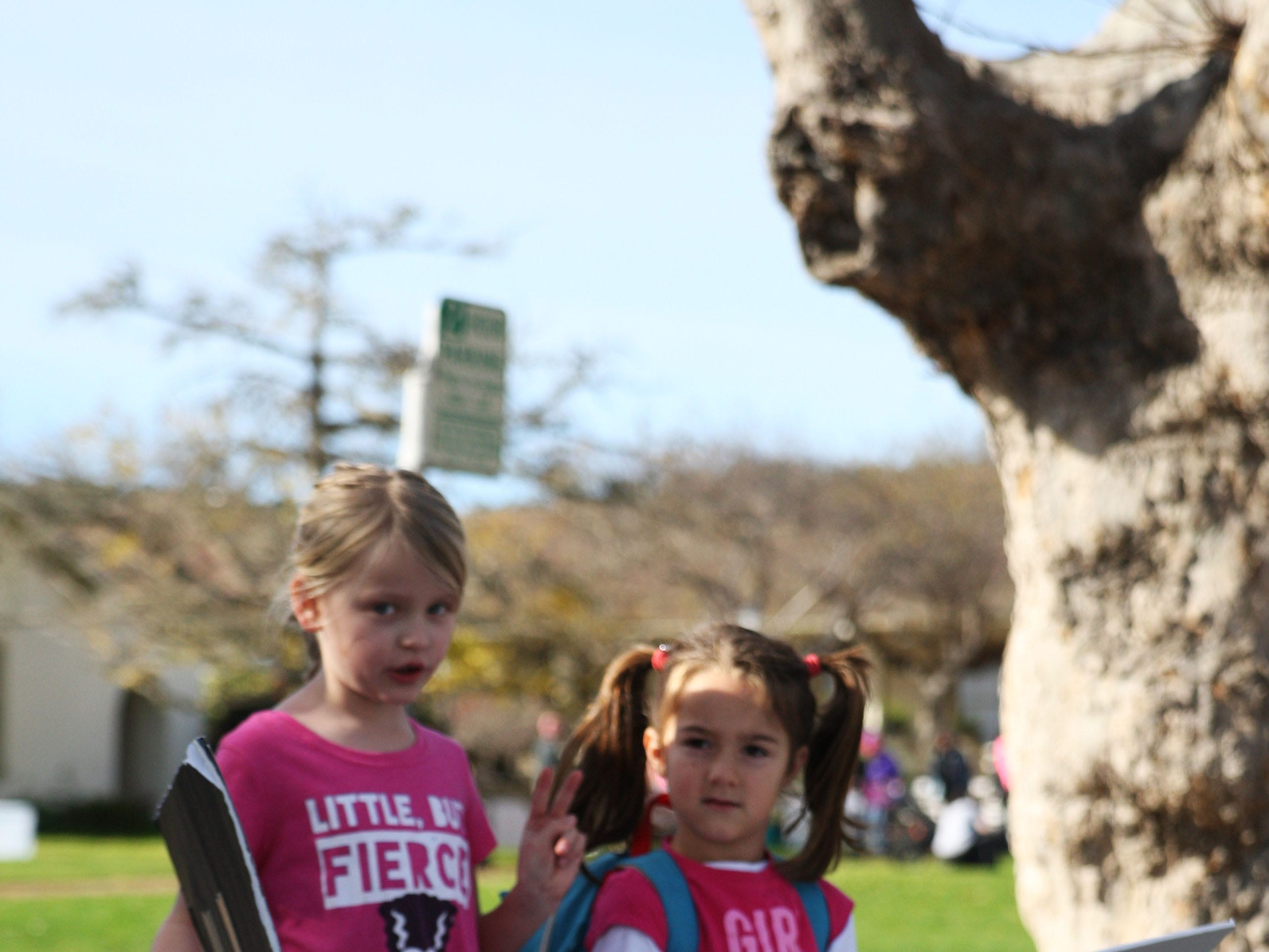Two girls march Saturday at the 2019 Women's March Monterey