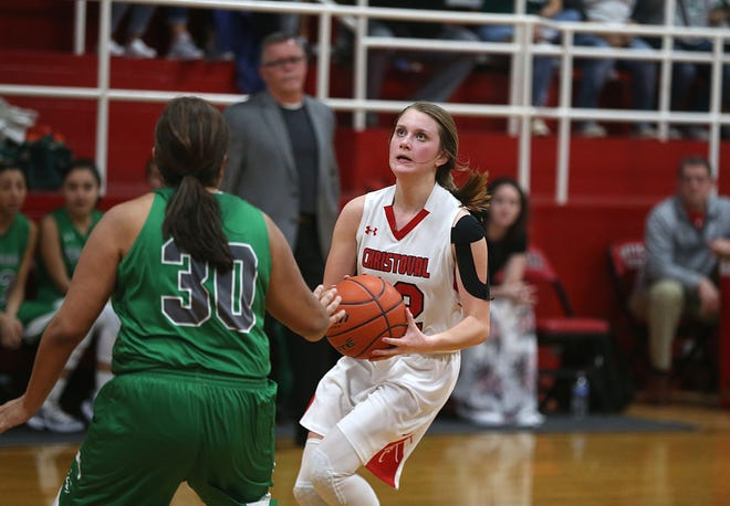 Christoval's Graci Jones (12) eyes the basket for a shot as she is confronted by Eldorado's Jadyn Martinez Friday, Jan. 18, 2019 in Christoval.