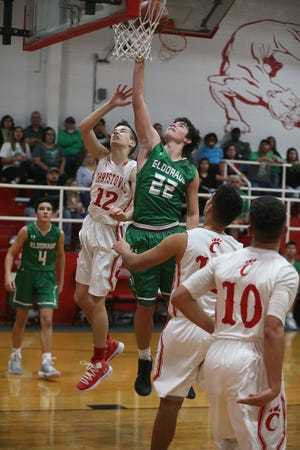 Eldorado's Aidan Dennis (22) attempts to make a basket as Christoval's Seth Baker (12) tries to block him Friday, Jan. 18, 2019 in Christoval.