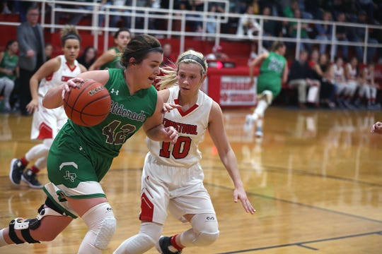 Eldorado's Codee Meador (42) tries to get past Christoval's Allison Vaughn (10) Friday, Jan. 18, 2019 in Christoval.