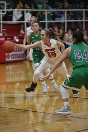 Christoval's Kayce Jackson (15) is surrounded by Eldorado Lady Eagles as she tries to gain control of the ball Friday, Jan. 18, 2019 in Christoval.