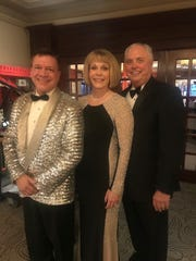 San Angelo's Terry Mikeska, left, poses with Clarissa and Rep. Drew Darby during the Legislative Black Tie Ball in Austin, where Mikeska entertained.