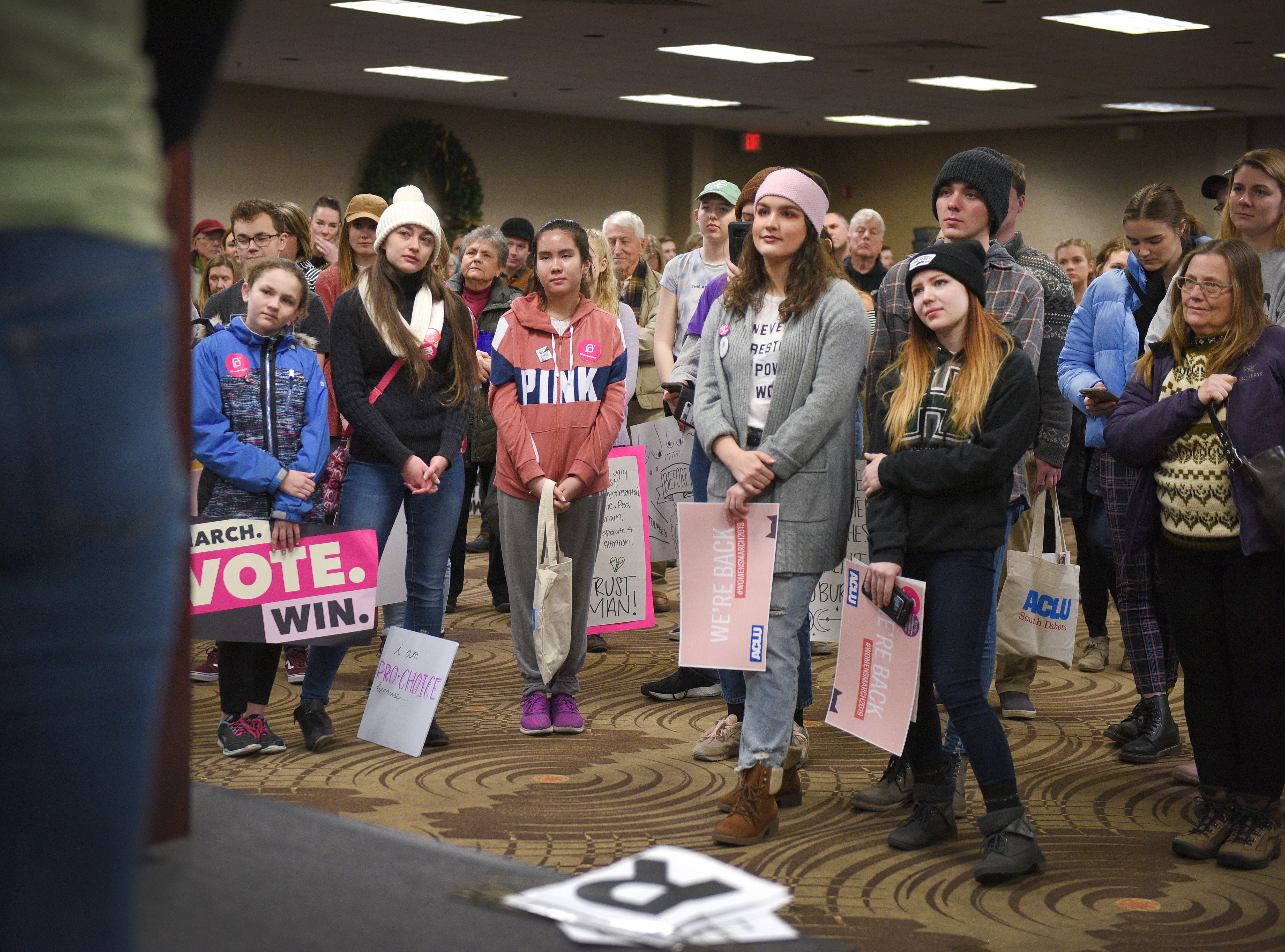People gather for the Women's March Saturday, Jan. 19, at the Downtown Sioux Falls Holiday Inn-City Centre in Sioux Falls.