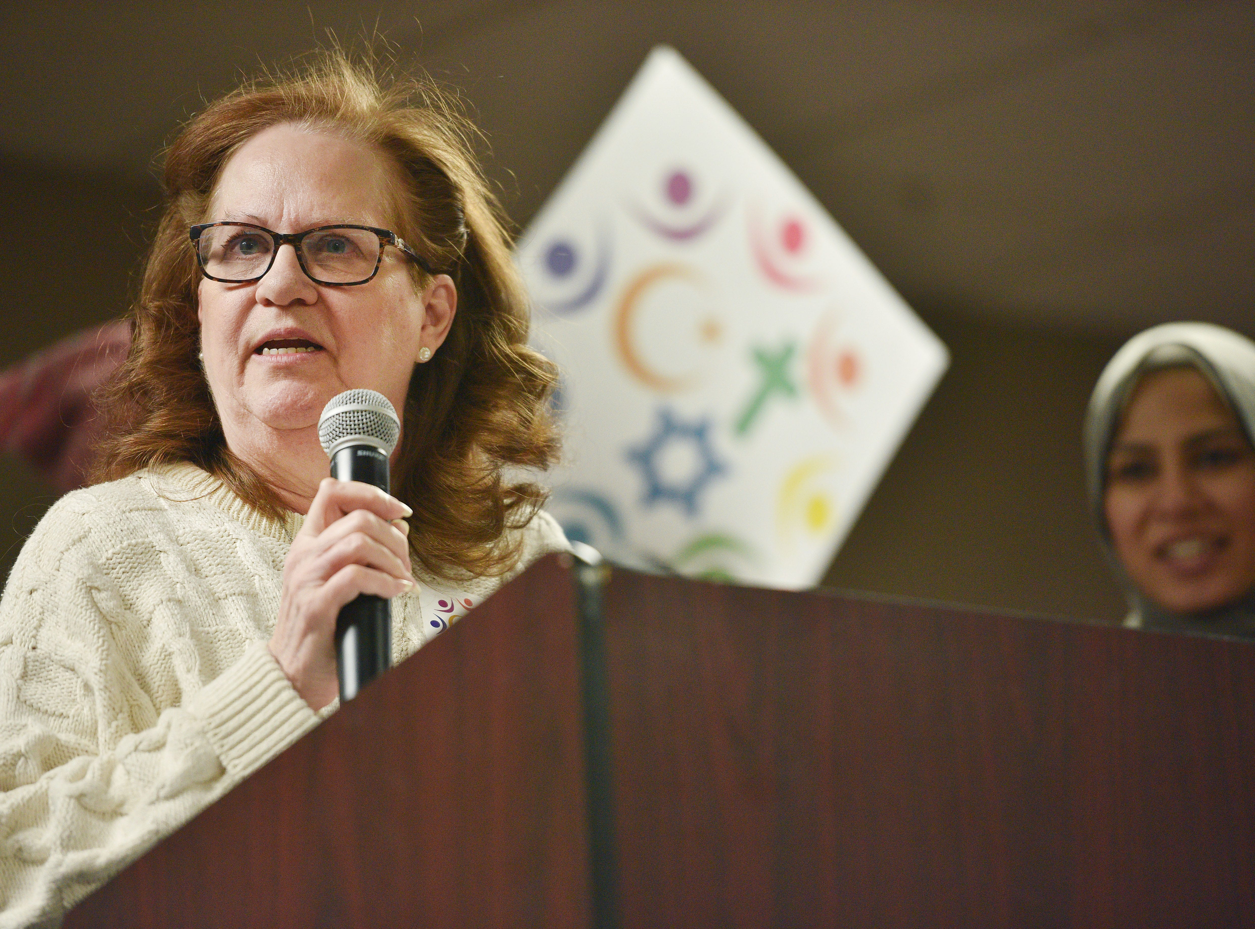 Jan Forstein speaks during the Women's March Saturday, Jan. 19, at the Downtown Sioux Falls Holiday Inn-City Centre in Sioux Falls.