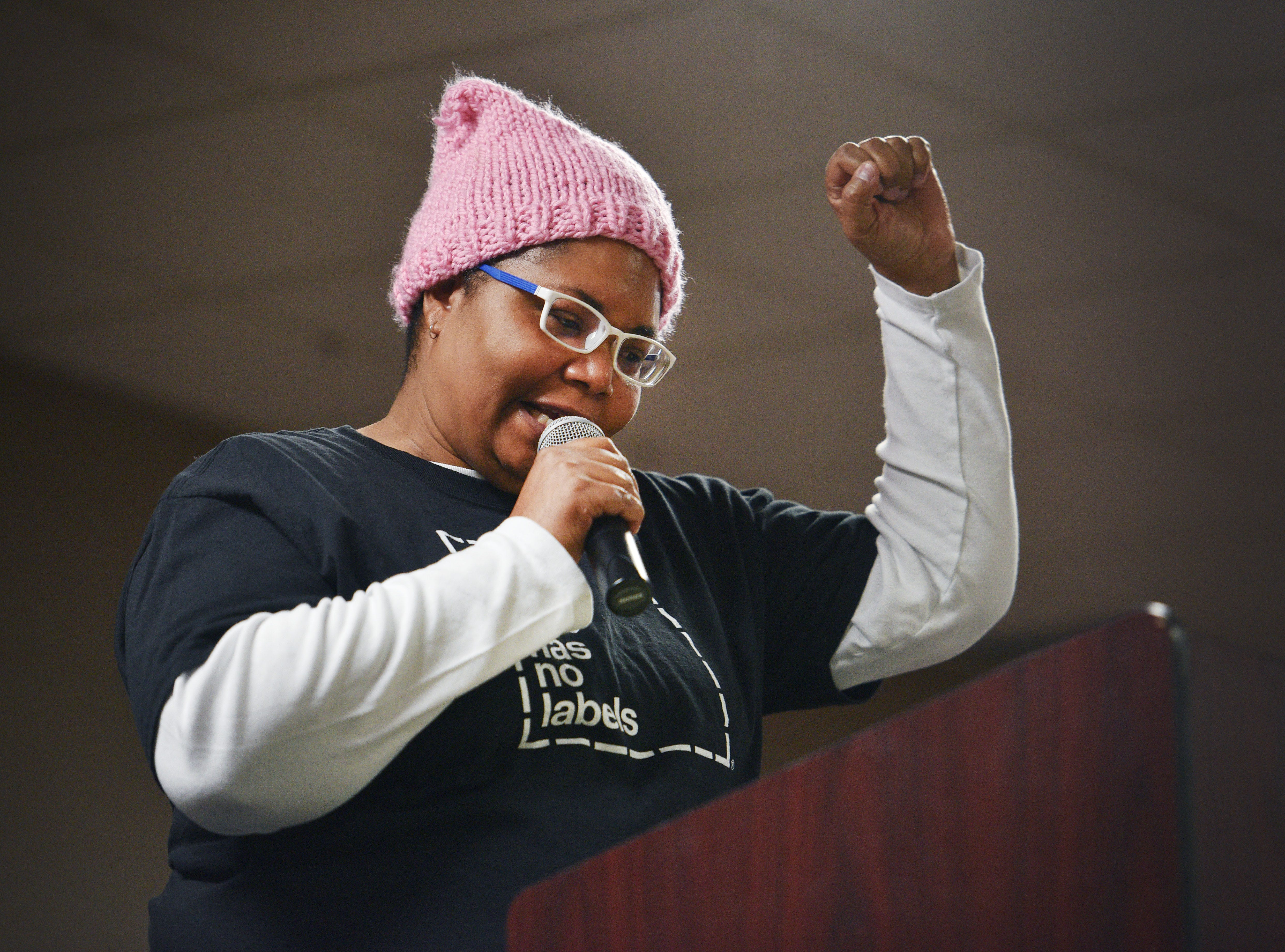 Denise Tucker speaks during the Women's March Saturday, Jan. 19, at the Downtown Sioux Falls Holiday Inn-City Centre in Sioux Falls.