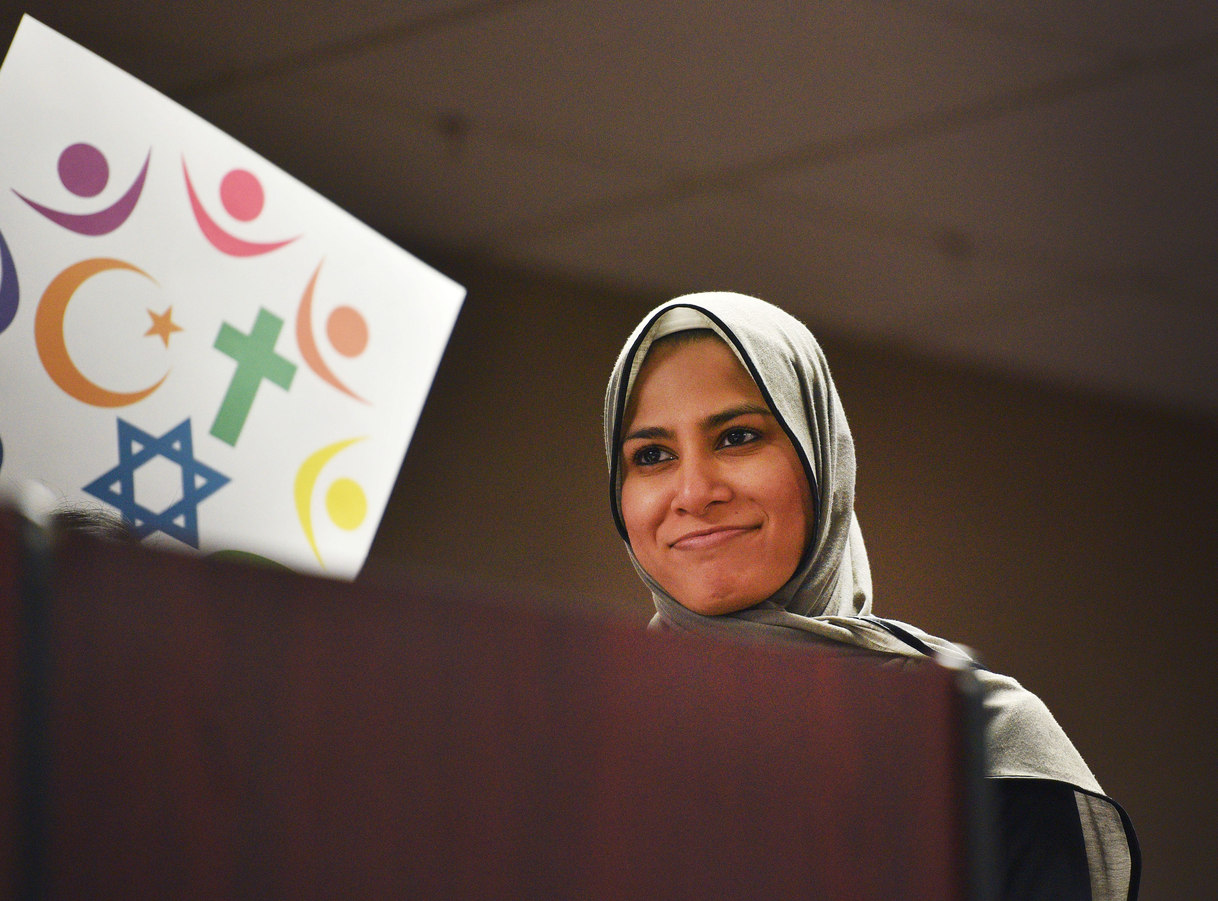 Sadaf Cassim speaks during the Women's March Saturday, Jan. 19, at the Downtown Sioux Falls Holiday Inn-City Centre in Sioux Falls.