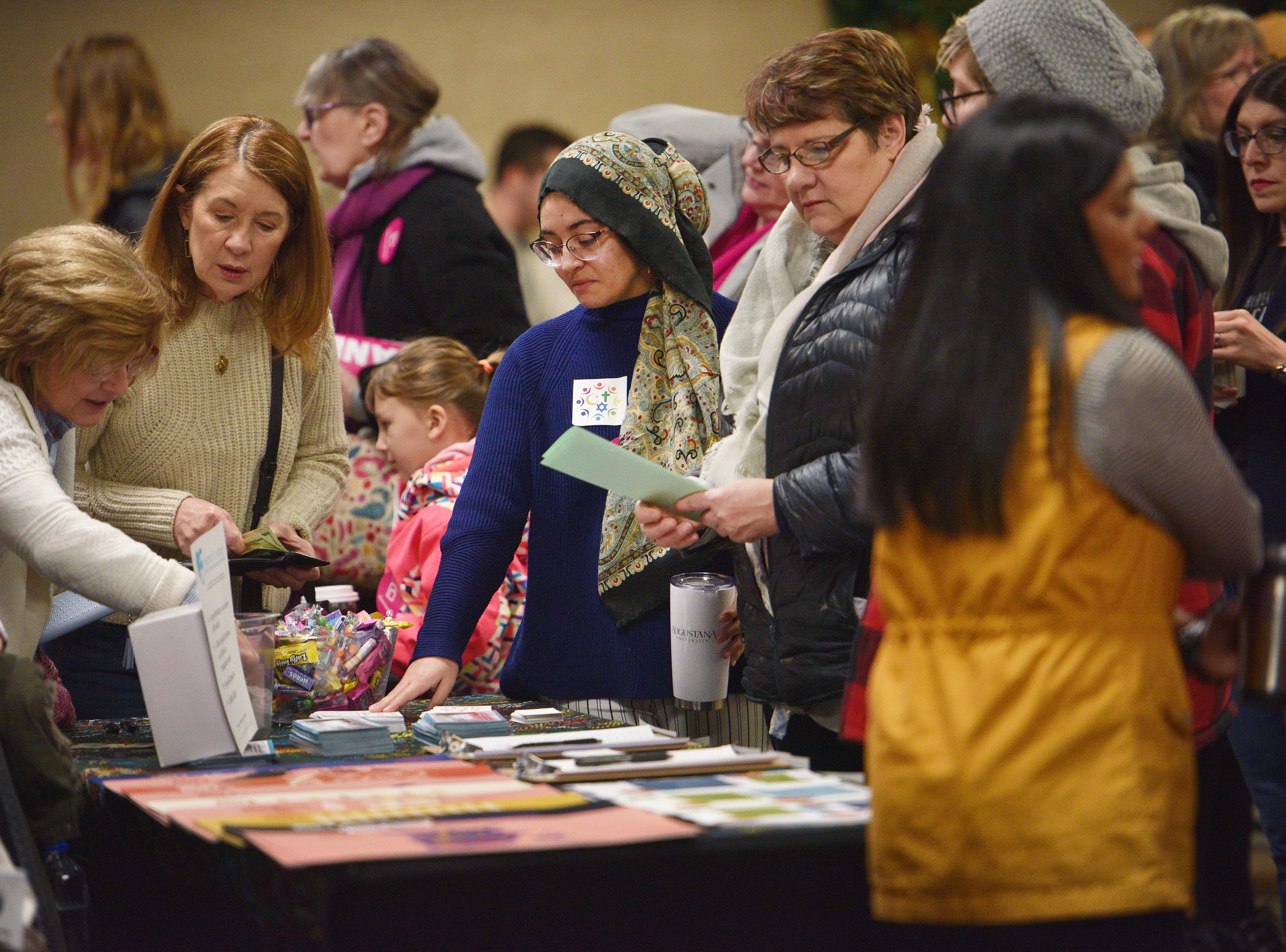 People look at different booths at the Women's March Saturday, Jan. 19, at the Downtown Sioux Falls Holiday Inn-City Centre in Sioux Falls.