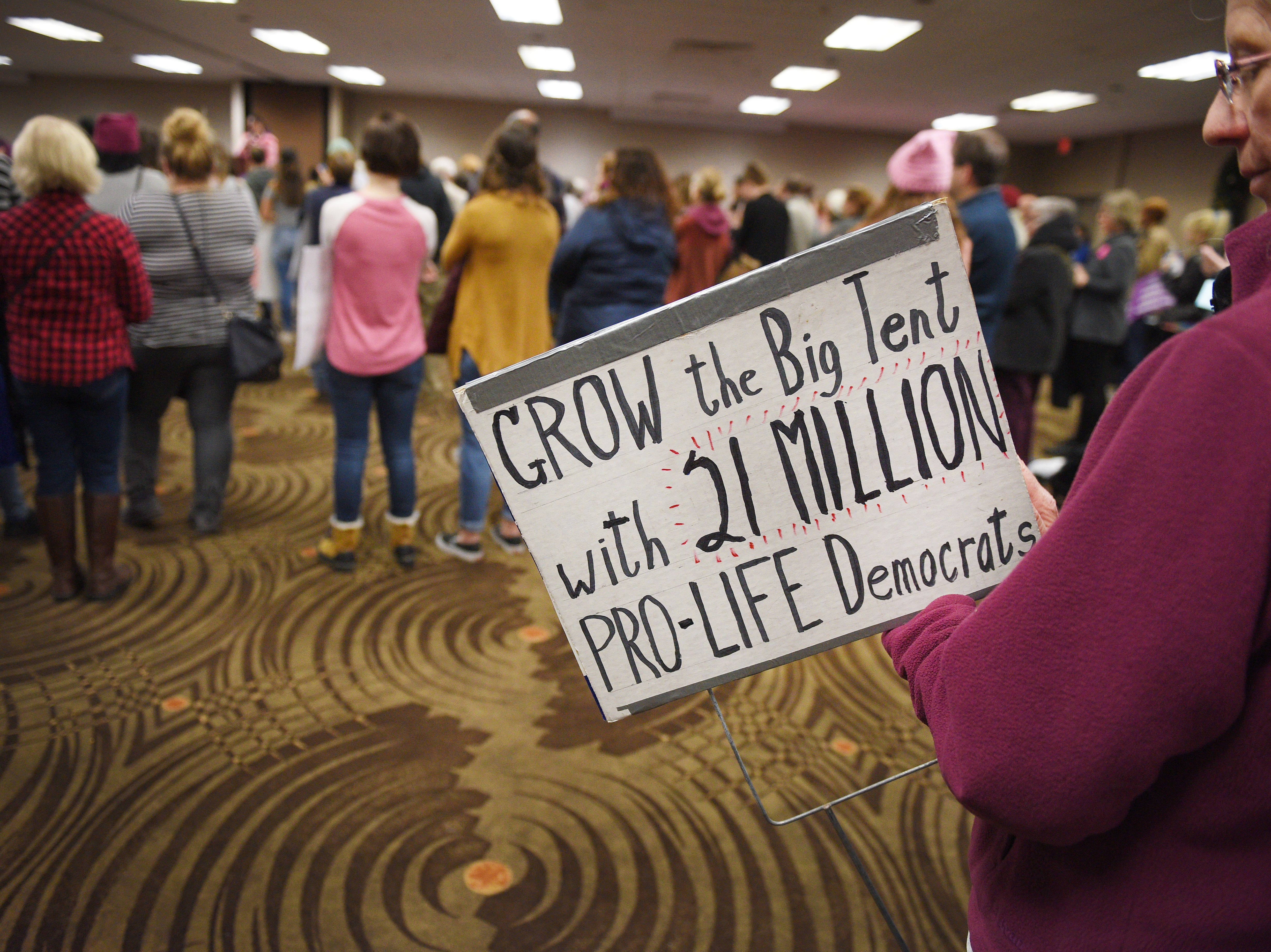 """A woman holds a sign that reads, """"grow the big tent with 21 million pro-life democrats"""" during the Women's March Saturday, Jan. 19, at the Downtown Sioux Falls Holiday Inn-City Centre in Sioux Falls."""