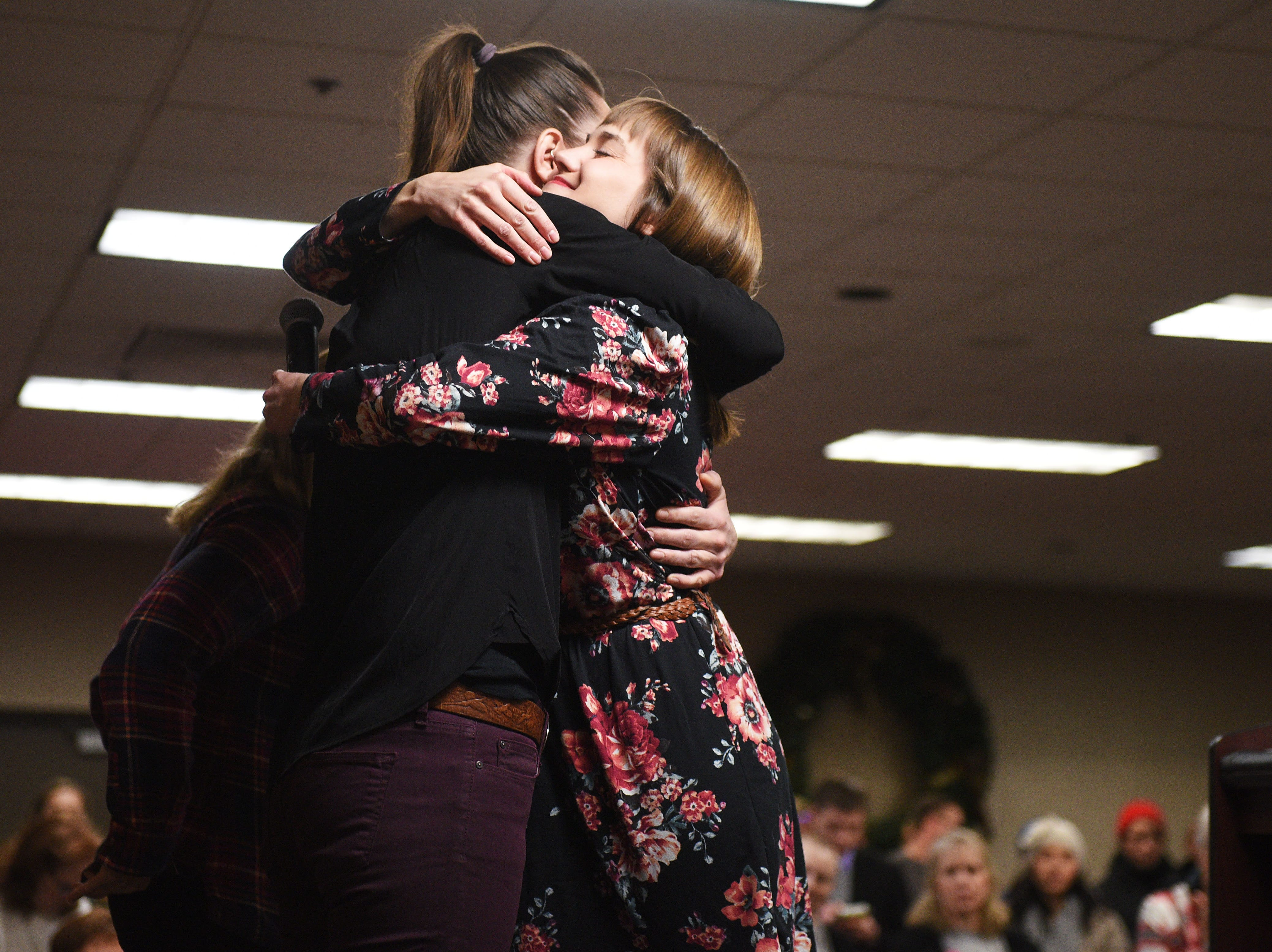 Representatives Kelly Sullivan and Erin Healy hug after their speeches during the Women's March Saturday, Jan. 19, at the Downtown Sioux Falls Holiday Inn-City Centre in Sioux Falls.