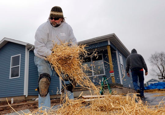 Kurt Jentzsch covers the driveway at the new Habitat for Humanity house on North Main in Springfield on January 18, 2019.
