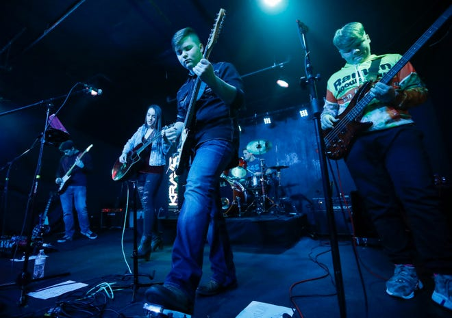 Jackson Martin, center, 17, a junior at Glendale High School, plays guitar with his band Fishing for Saturday at Krave on Friday, Jan. 18, 2019.