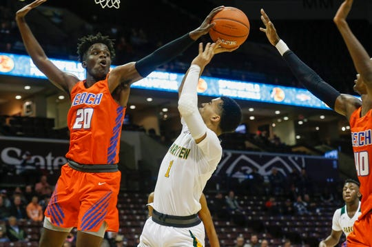 Dontae Taylor, of Parkview, has his shot blocked by Javion Garrett during the Vikings' 75-46 loss to Rainier Beach in the Bass Pro Shops Tournament of Champions at JQH Arena on Friday, Jan. 18, 2019.