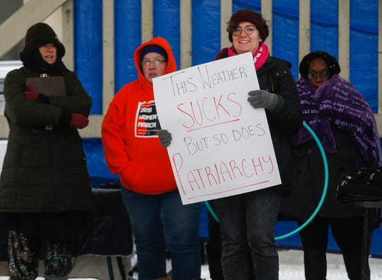 Close to 100 people braved the bitterly cold weather to attend the Women's March at Park Central Square on Saturday, Jan. 19, 2019.