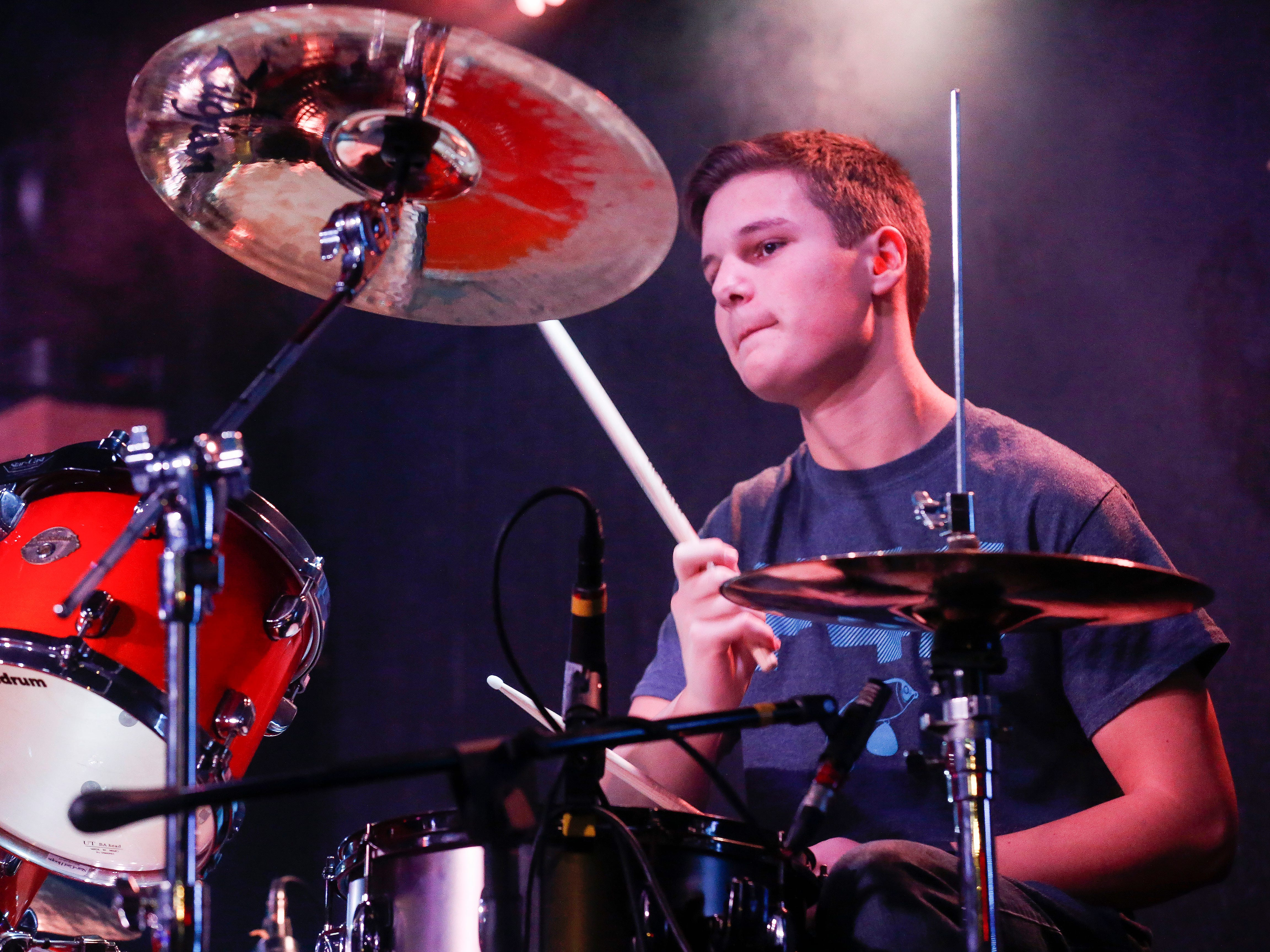 Josh Henry, 16, a junior at Greenwood Laboratory School, plays drums with his band Fishing for Saturday at Krave on Friday, Jan. 18, 2019.