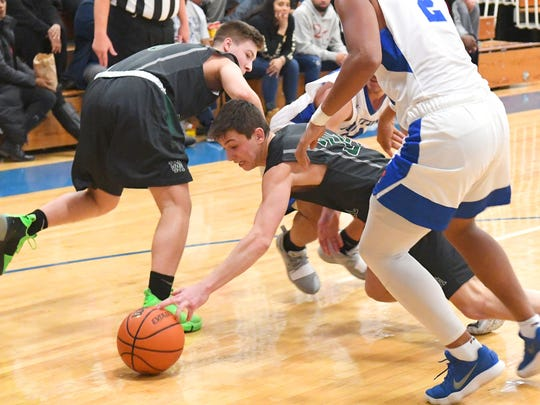 Wilson Memorial's Gabriel LaGrua scrambles after a loose ball during a game played in Staunton on Friday, Jan. 18, 2019.