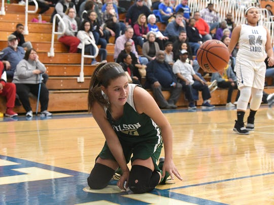 Wilson Memorial's Madison Flint goes down after taking a shot at the basket during a game played in Staunton on Friday, Jan. 18, 2019.