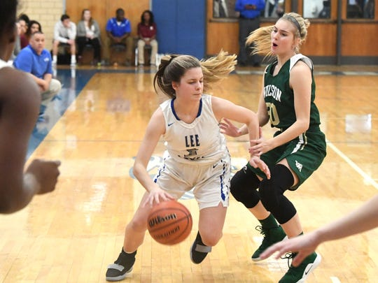 Robert E. Lee's Kellsye Miller moves the ball while guarded by Wilson Memorial's Korinne Baska during a game played in Staunton on Friday, Jan. 18, 2019.