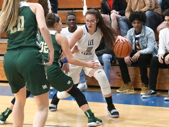 Robert E. Lee's Emma Witt has the ball as she is guarded by Wilson Memorial's Paris Hutchinson (#20) and Madison Flint (#32) during a game played in Staunton on Friday, Jan. 18, 2019.