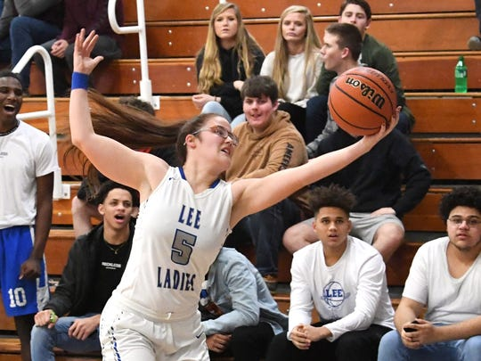 Robert E. Lee's Emma Witt stretches to keep the ball in bounds during a game played in Staunton on Friday, Jan. 18, 2019.